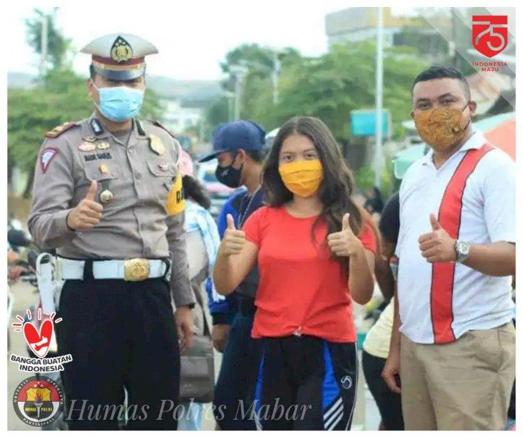 Polres Mabar bersama AMM Bagikan Masker di Pasar Batu Cermin
